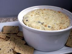 OLIVE AND ARTICHOKE DIP 14 oz of canned or jarred Artichoke Hearts  10 whole Black Olives  8 ounces, Cream Cheese  1 cup  Mayonnaise  1 whole Egg  1/4 cup sweet Onion, Diced  1/4 cup Grated Parmesan Cheese  3 dashes Worcestershire Sauce  Salt and Pepper, to taste  Cayenne Pepper  More Parmesan for topping (optional)