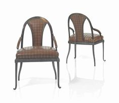 EDGAR BRANDT (1880-1960) A PAIR OF ARMCHAIRS, CIRCA 1926 wrought-iron, leather upholstery each 34 5/8 in. (88 cm.) high each stamped E BRANDT FRANCE