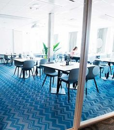 Vibrant blue flooring using Bolon By Missoni Cyan in the restaurant at the RC Hotel in Jönköping, Sweden