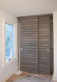 This is one of the bedroom's closet. The simple horizontal slats is just perfect to hide closet stuff. So sleek and modern.