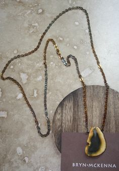 I love this one. have a similar one and use it tons! BRYN MCKENNA - ROCK ON Necklace - 1 Brown/Yellow, $36.00 (http://brynmckenna.com/rock-on-necklace-1-brown-yellow/)