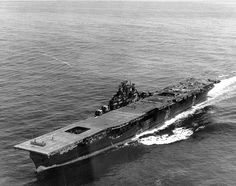 The most-heavily damaged fleet carrier to survive the war, the USS Franklin approaches New York, April 24, 1945