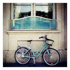 lovely palette: aqua, silver, beige. i want that bike...