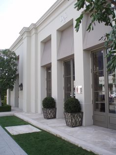 Stucco, Awnings, Beautiful custom narrow-stile paneled doors... Done!   Dennis & Leen L.A.