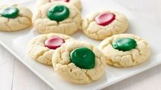 Holiday Thumbprints Kids will have fun filling these easy thumbprint cookies with colored icing. Easy Christmas Cookie Recipes, Holiday Cookies, Christmas Desserts, Holiday Recipes, Christmas Cocktails, Holiday Treats, Sugar Cookie Dough, Cookie Icing, Sugar Cookies