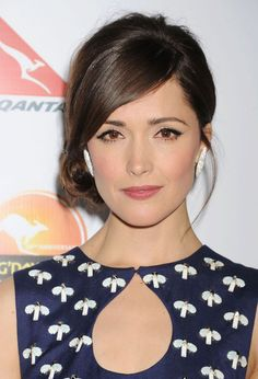 """Celebrity Haircut: Rose Byrne's Straight Bangs Leave it to Rose Byrne to avoid the awkward stage of growing out your bangs altogether. We love the way she keeps the longer fringe stick straight for a completely different look from her former blunt bangs. """"For a deep-parted side fringe have your stylist use the outside corner of the eyebrow as a guide for parting the hair,"""" says Serafino."""