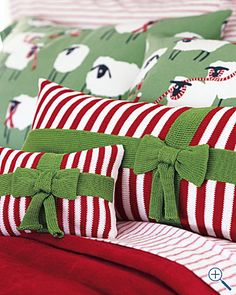Striped Christmas Bow Pillow.. black and white stripe with gold bow