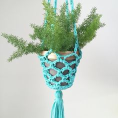Crochet a cool, macrame-inspired plant hanger using upcycled jersey yarn!