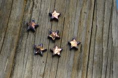 These star charms were fired with stains and a shiny glaze, then fired again with blue/purple and gold lustres. Price is for one approximately 15 mm star charm.