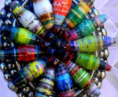 Paper beads are really colorful and unique and can be made from old magazines or craft paper using nothing but a toothpick, a glue stick, scissors, and modge podge. One page of a magazine makes about 30 beads; two pages is enough for a bracelet and earring set.
