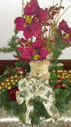 """Diy Christmas table top centerpiece: 18"""" round styrofaom base, some garland, bow, musical bear, 3 holly  flowers, 4 lg ornaments, 2 grape pieces. And a short string of christmas light run thru the garland. Beautiful when you plug it up. Just arrange them any way you like. Makes a beautiful centerpiece on any table."""