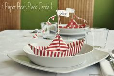 paper boats in cute nautical paper? yes please! these would be cute food label holders...