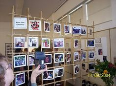 """""""living room"""" reading area in classroom with photos of students and families"""