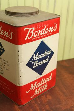 Borden's Meadow Brand Malted Milk Red white and blue tin with a screw on lid advertising tin $38