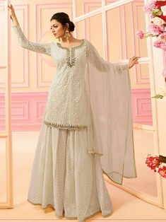 Bollywood diva drashti dhami style off white designer palazzo suit online which is crafted from net fabric with exclusive embroidery and hand work. This stunning designer palazzo suit comes with chanderi jacquard bottom santoon inner and net dupatta. Lehenga Choli, Pakistani Sharara, Sharara Suit, Pakistani Dress Design, Anarkali Dress, Pakistani Dresses, Indian Dresses, Indian Outfits, Sari