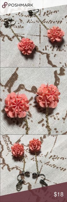 """Vintage flower celluloid dangle clip-on earrings These coral colored earrings are lightweight and an interesting material. I'm unsure of the exact material but consultants have stated it appears to be celluloid.  Excellent condition.  Measure 2"""" in total length. Vintage Jewelry Earrings"""