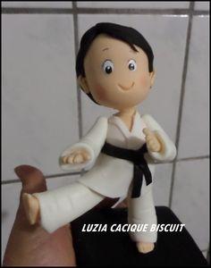 Luzia Cacique Biscuit: LUTADOR DE JIU JITSU
