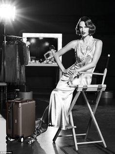 All change: In a new Great Gatsby-inspired campaign for German luggage firm, Rimowa, Victo...