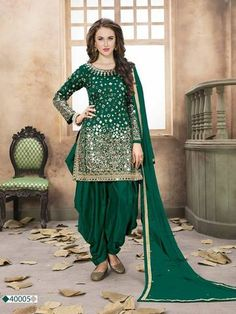 Exclusive Green Color Tafeta Silk Mirror Work Party Wear Patiyala Salwar Kameez Make way of some exotic collection to your wardrobe. Get the exquisite look by wearing this green color heavy mirror work patiyala salwar kameez. The fabric of top is made of Patiala Dress, Patiala Salwar Suits, Punjabi Dress, Punjabi Suits, Sari Dress, Shalwar Kameez, Designer Salwar Kameez, Wedding Salwar Kameez, Designer Anarkali