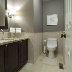 medium gray and cream/beige bathroom with dark brown cabinets