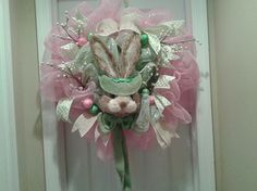 EasteWreath, bunny with burlap accents, deco mesh and ribbon accents.