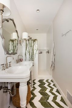 This is one subtle way to add greenery to your bathroom- look at the tiles and the creepers on the shower partition