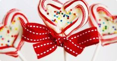 With a couple handfuls of leftover Christmas candy canes, you can make these fabulously fun candy cane and white chocolate lollipops! Just make a heart shape with the candy canes, bake them for a short time to melt them together, and spoon a small amount of melted white chocolate into the center of each heart. Once they're cool, wrap and tie them up with a pretty red ribbon for a lovely gift.