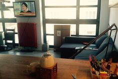Living room - making of. Orange fusioned heater, grey sofa, wide windows. Lovely kitchen pot.