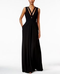 The plunging neckline of this glamorous gown from Jill Jill Stuart is accented by strappy details that bring bold design to the look. Pockets make a handy finishing touch, too! | Polyester; lining: po