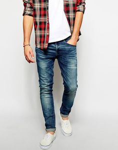 light summer jeans, a white tee, a checked shirt and white sneakers