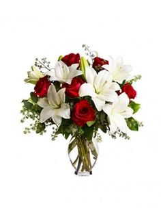 Beautiful bunch of 6 red roses and 3 white oriental lilies in a glass vase http://bookurgift.com/294-affectionate-hug