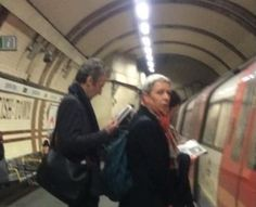 peter capaldi and his wife catching the tube earlier.....he must sometimes hate the invention of the camera phone!