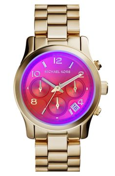 Gold Michael Kors watch with pretty iridescent colors that shines when you move.