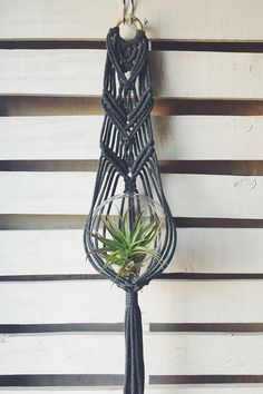 Slightly boho, totally classic. Inspired by my travels in Mexico and handcrafted in my little home studio in Denver Colorado, this vintage-meets-modern macrame plant hanger is designed to brighten any window or make a serene statement up on a wall. Hand-woven with durable, soft stretch cotton blend 5mm cord to fit a 6 inch Medium Glass Globe Terrarium or planter (neither are included) Measurements: Approximately 4 inches wide 31 inches long (without pot) Best suited for indoor use or in a…