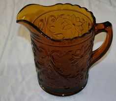 I would love to add an Amber Tiara pitcher to my collection!  Vintage Tiara Amber IND Glass Pitcher