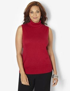 A style staple of the season, this sleeveless turtleneck is unique with its sparkling metallic yarn along the cozy knit fabric. Ribbing detail completes the collar and hem. Pair with our Pointelle Shimmer Cardigan for a lovely layered look. Catherines tops are designed for the plus size woman to guarantee a flattering fit. catherines.com