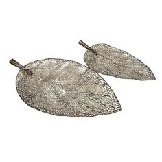 IMAX Elise Cutwork Leaf Tray, Set of 2 by Imax. $50.05. Set includes two trays, one large and one small. Trays measure 15.25-inch height  by 27.5-inch wide. Trays are lovely enough to display as art. Use them under a collection of coordinated candles as a beautiful centerpiece.. Elise cutwork leaf trays have a fragile look that belies the strength of their iron construction. Bringing the designer's sketchbook to life, the Elise Cutwork Leaf Trays are delicately ethereal pieces, ...