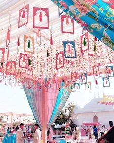 Hanging ceiling decor trend | Mehendi Decor Inspiration | Mehendi Decor Ideas | Hanging frames with tassels | Pink, Blue and Peach Mehendi Decor | Day Occassion decor Ideas | Function Mania