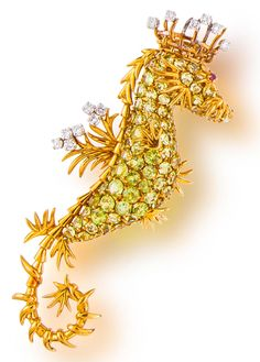 A peridot and diamond 'seahorse' brooch, Jean Schlumberger, Tiffany & Co., French designed as a seahorse set with circular-cut peridot, accentuated by round brilliant-cut diamonds and a circular-cut ruby eye; signed Tiffany for Tiffany & Co., Schlumberger, made in France, with French maker's mark and assay mark; mounted in eighteen karat gold; length: 3 1/2in.