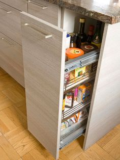 Slide-out Pantry- Never lose another food staple in the recesses of your cabinets again. A slide-out cabinet with shelves keeps cereals, cooking essentials, and snacks organized, and a quick tug of the handle puts everything in few. Plus, the front panel matches the surrounding cabinetry for a consistent look with added functionality.
