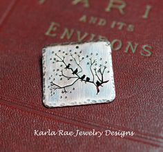 Birds on a branch, copper handsawn pendant.  Karla Rae Jewelry Designs