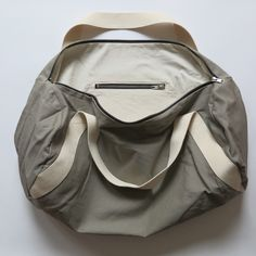 Here's a nice interior view of the duffle bag. I really like the combination of black zippers with silver, taupe & natural canvas. Modern Sewing Patterns, Diy Kits, Zippers, Taupe, Canvas, Nice, Natural, Interior, Silver