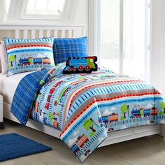All aboard the train to sweet dreams! These adorable 3-piece reversible comforter sets make the perfect addition to any kids' bedroom. Bonus plush train pillow included.