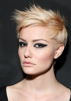 Blonde pixie haircut with short side swept bangs and low-lights hairstyle