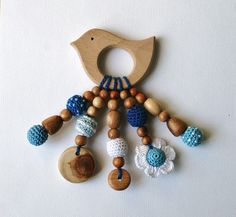 """Baby teething toy is ready to ship. Organic wooden teether made with natural, unfinished wooden beads (maple and apricot) and crocheted with 100% cotton yarn. Beads measure about 0,7"""" / 18mm in diameter. Attention: although this teething bracelet was made to be very safe for children,"""