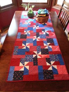 Patriotic pinwheels table runner - all people quilt pattern I'd make it into a lap size quilt! Patchwork Table Runner, Table Runner And Placemats, Quilted Table Runners, Skinny Quilts, Small Quilt Projects, Place Mats Quilted, Pinwheel Quilt, Quilted Table Toppers, Quilt Of Valor