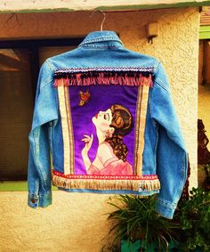 "Modified ""Kiss from a Butterfly"" pin up by Henry Clive custom painted on a denim jacket with fringe by @bleudoor on Instagram"