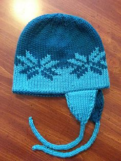 This hat is knit in a round in the double knit stitch. It has color work with a chart to follow. It is reversible and very warm because of the double thickness.
