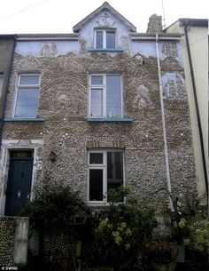 Previous owners plastered the house on Lake Street, Dartmouth, with assorted shells three decades ago