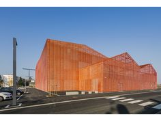 forum of saint louis manuelle gautrand architecture alsace france cultural sporting facility Orange Architecture, Brick Architecture, Industrial Architecture, Architecture Images, Contemporary Architecture, Contemporary Design, Factory Architecture, Alsace France, Metal Facade